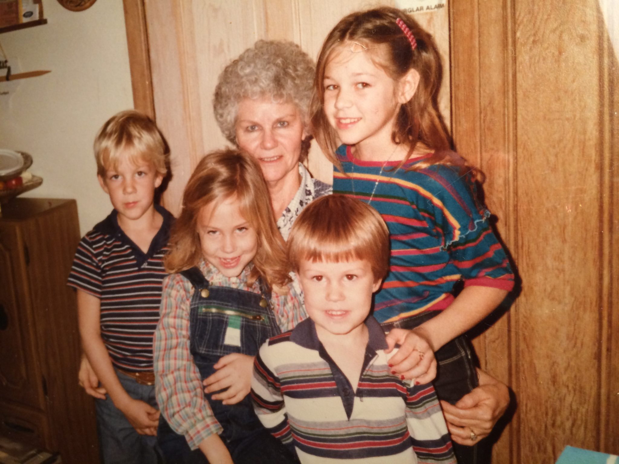 LOVE this picture. I'm wearing overalls (probably 6 yrs old), my brother, 4, is in front, while my cousins Justin and Amy are on either side of Grandma.